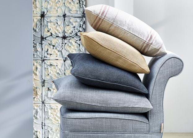 Grace scatter cushion stack on Madeleine chair