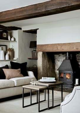 Grace scatter cushion in Harris Tweed Marmalade on sofa