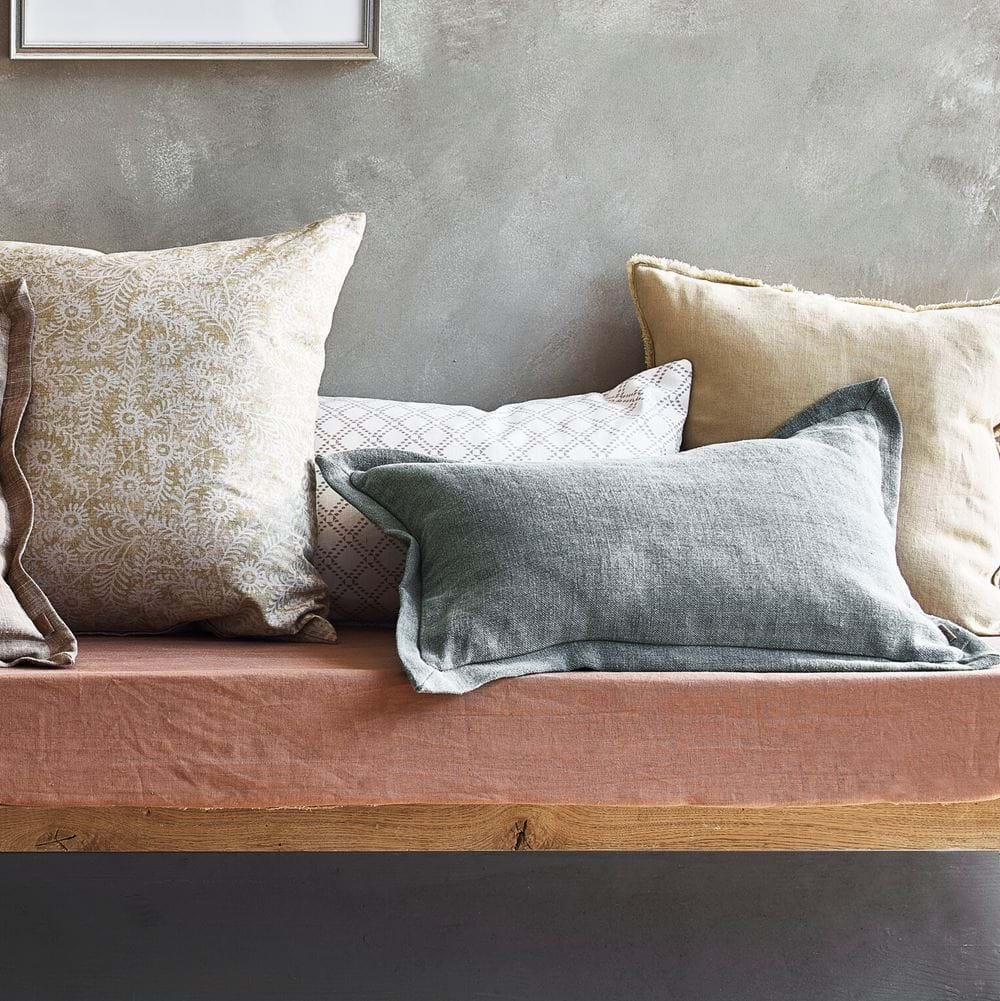 Scatter cushions on bench