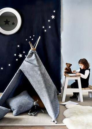 Playroom teepee with child