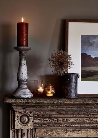 Warm candles on mantle