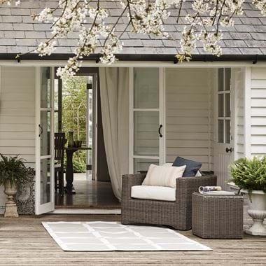 Burford rug on decking outside summer house