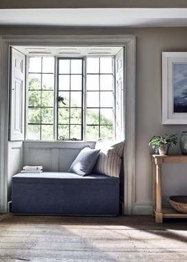 Eloise ottoman in window